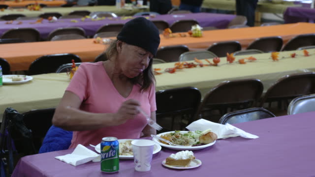 human impact and physical destruction caused by the deadliest wildfire in california history evacuees are provided a thanksgiving meal at a shelter... - comfort food stock videos and b-roll footage