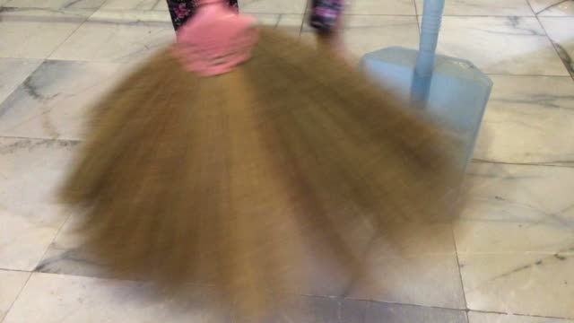 human is sweeping floor