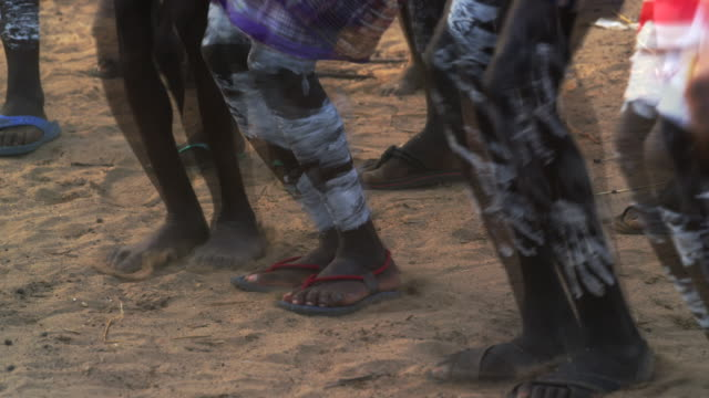 human legs jumping on ground / ethiopia, africa - slipper stock videos & royalty-free footage
