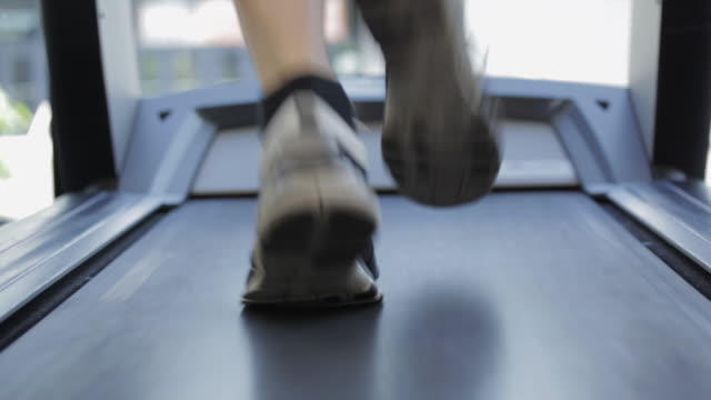 CU Human legs running on treadmill machine in gym / Vancouver, British Columbia, Canada