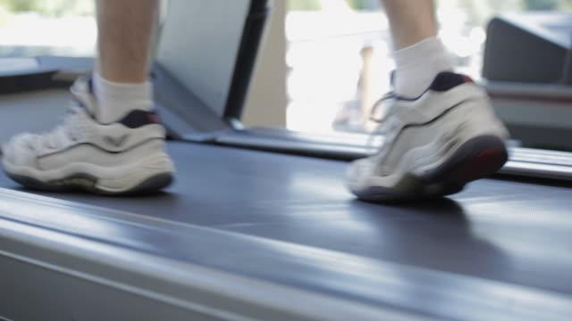 cu human legs running on treadmill machine in gym / vancouver, british columbia, canada - treadmill stock videos & royalty-free footage