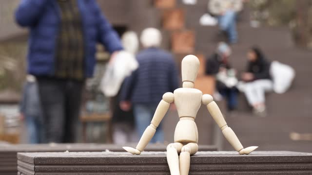 human model sitting alone on the bench - puppet stock videos & royalty-free footage