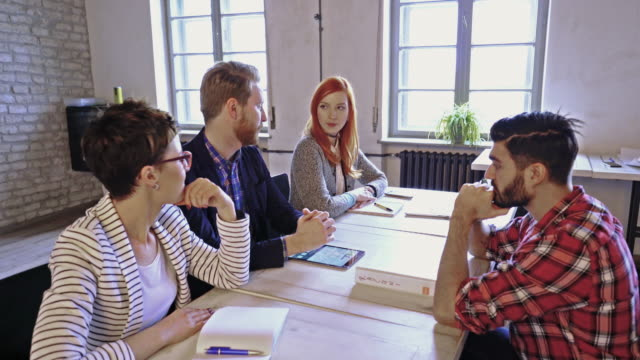 human resource team having a meeting with potential candidate during job interview in the office. - job interview stock videos and b-roll footage