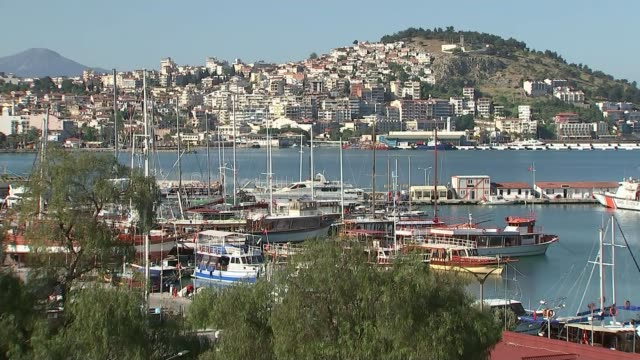 human rights concerns linked to criticism of the president turkey kusadasi ext high angle gv of city skyline / rooftops of city pan to harbour setup... - aydın province stock videos and b-roll footage