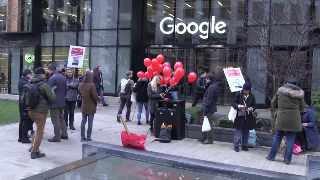 human rights groups protest outside google's king's cross office in london to demand that it scrap project dragonfly, a controversial plan to build a... - censorship stock videos & royalty-free footage