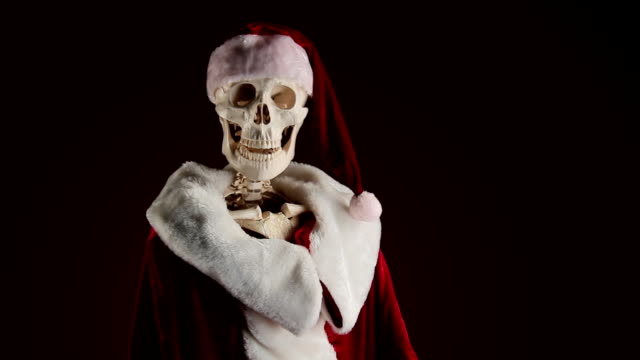 Human skeletal Santa Claus waving