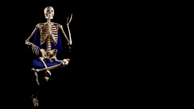 human skeleton sitting at chair and talking - office chair stock videos & royalty-free footage
