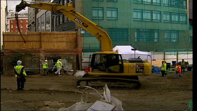 human skull and skeleton unearthed on building site in east london forensic officers at site as one along into forensics tent general view of... - human back stock videos & royalty-free footage