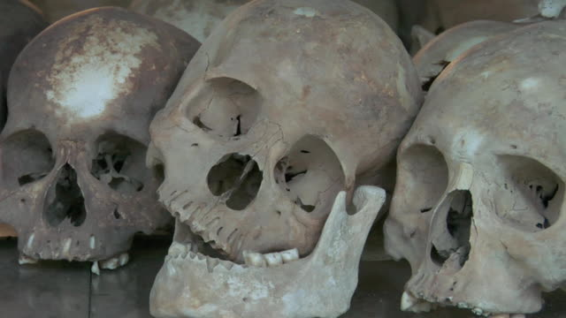 pan cu human skulls displayed at choeung ek, a killing fields memorial / phnom penh, cambodia - cambodia stock videos and b-roll footage