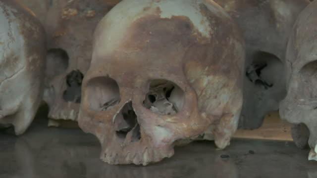 pan cu human skulls displayed at choeung ek, a killing fields memorial / phnom penh, cambodia - genocide stock videos & royalty-free footage