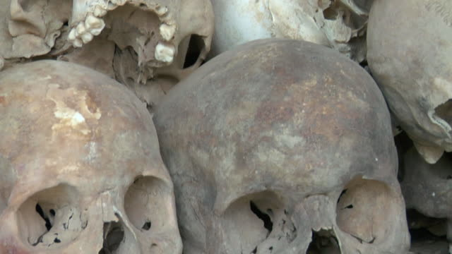 tu cu human skulls displayed at choeung ek, a killing fields memorial / phnom penh, cambodia - large group of objects stock videos & royalty-free footage