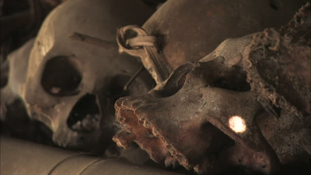 human skulls line a bamboo shelf. - ceremony stock videos & royalty-free footage