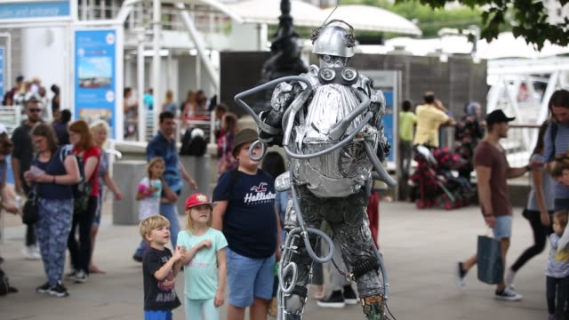 a human statue on london's south bank uk - street performer stock videos & royalty-free footage