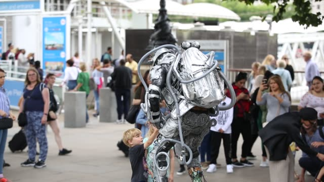 human statue on london's south bank, uk. - silver coloured stock videos & royalty-free footage