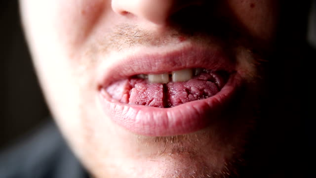 human tongue. close up. isolated. - human tongue stock videos & royalty-free footage