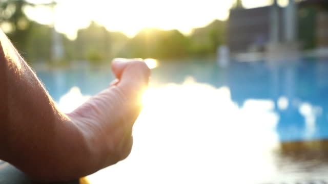 human workout yoga and meditating at poolside  , sun flare ,zoom in - deltoid stock videos and b-roll footage