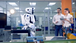 Human-like robot is coming to the engineers who control it remotely and give it a drill