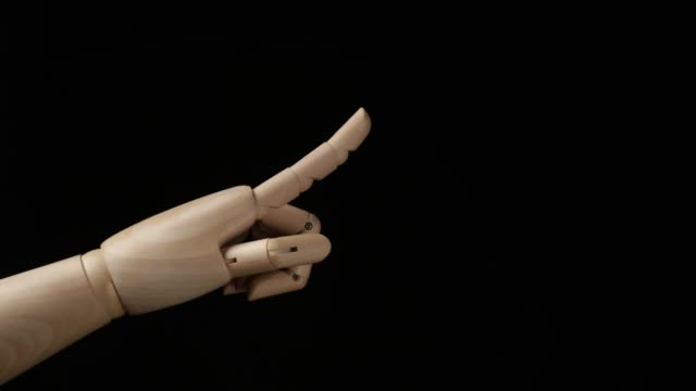 vídeos de stock e filmes b-roll de humanoid hand touch something. - apontar sinal manual