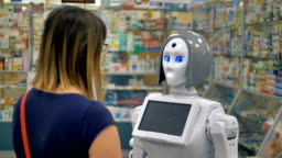 A humanoid robot consults a woman inside a drugstore.