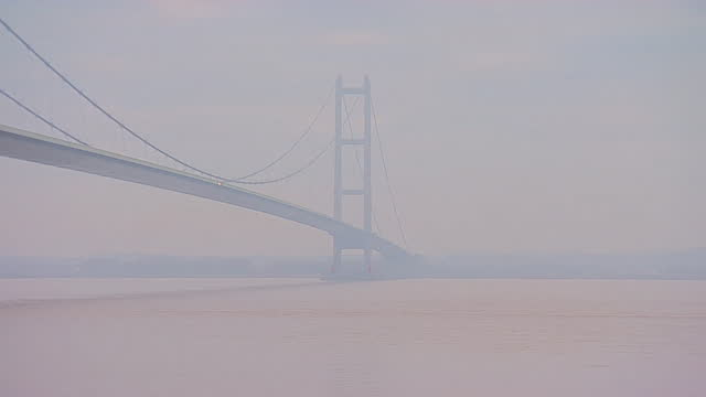 humber bridge in fog - suspension bridge stock videos & royalty-free footage