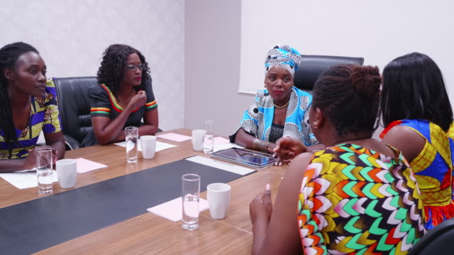 humble african businesswoman listening to her staff in a group meeting - chairperson stock videos & royalty-free footage