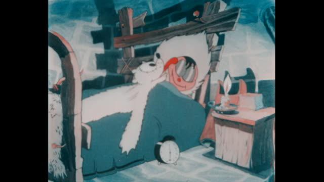 vidéos et rushes de humble eskimo sets his clock for summer and settles down to sleep - cartoon
