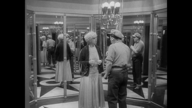 1931 humble man speaks to classy woman about missing reporter in glitzy mirrored hallway - 1931 stock videos & royalty-free footage
