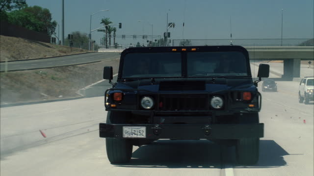 ms pov hummer crashing into cars from behind on road - hummer stock-videos und b-roll-filmmaterial