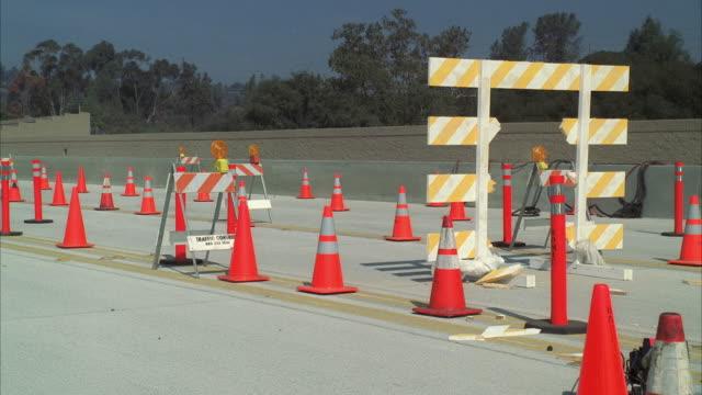 ws pan hummer crashing through freeway construction barrier - hummer stock videos & royalty-free footage
