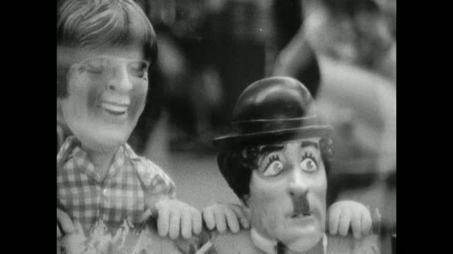 humorous cartoon characters pop up and down; 1966 - puppet stock videos & royalty-free footage