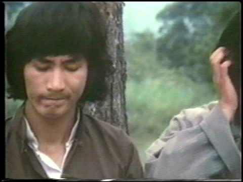 vidéos et rushes de humorous dubbed dialogue, woman persuades two men to train under her father. humorous dubbed dialogue on january 01, 1980 in hong kong, china - persuasion