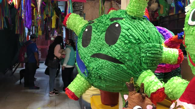 humorous pinata representing covid19 on the handcraft market of coyoacan picturesque district on december 12, 2020 in mexico city, mexico.... - papier stock videos & royalty-free footage