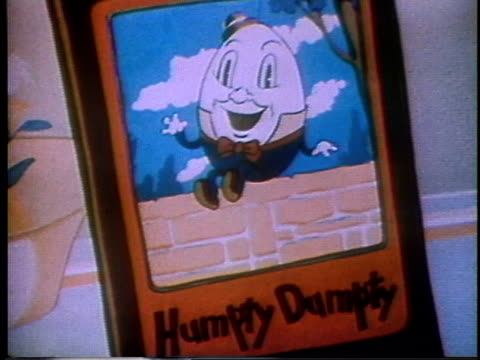 1935 montage humpty dumpty sings a song while teetering on the edge of a vase prompting his mother to scold him to 'come down from there' - 掃く点の映像素材/bロール