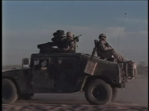 humvee drives, with soldiers inside and on top of it. - al fallujah stock videos & royalty-free footage
