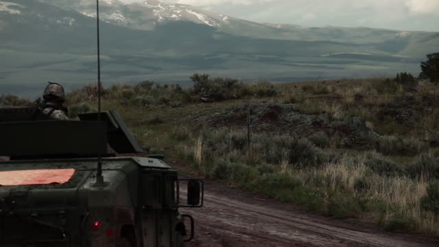 stockvideo's en b-roll-footage met humvee on a dirt road amid training explosives. - humvee
