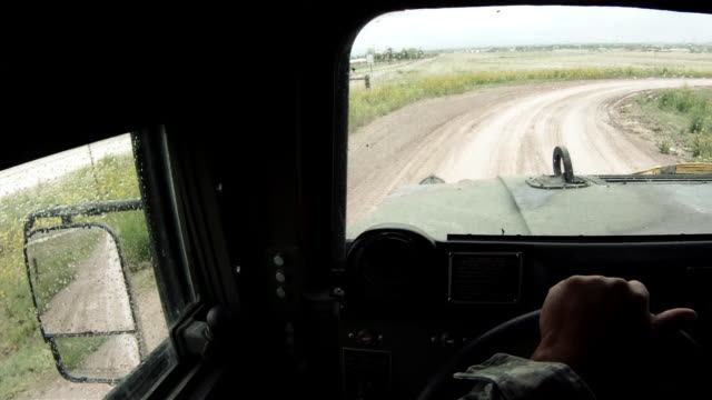Humvee while driving in a convoy taking a turn.
