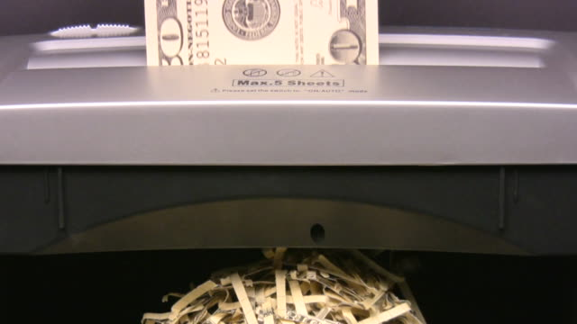 $100 hundred dollars bills into paper shredder. currency. finance. money. - one us dollar note stock videos & royalty-free footage