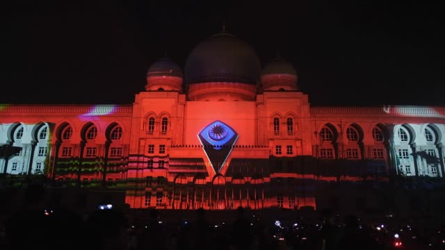 hundred of malaysian people gather at the palace of justice building covered by projection mapping ahead of the new year 2020 celebrations on... - putrajaya stock videos & royalty-free footage