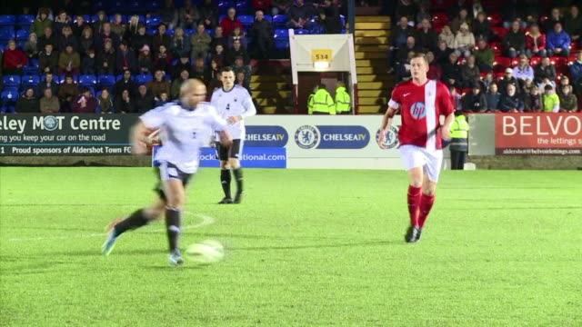 stockvideo's en b-roll-footage met a hundred years after the first world war british and german armies met on a pitch yesterday to recreate the mythical football game that took place... - aldershot