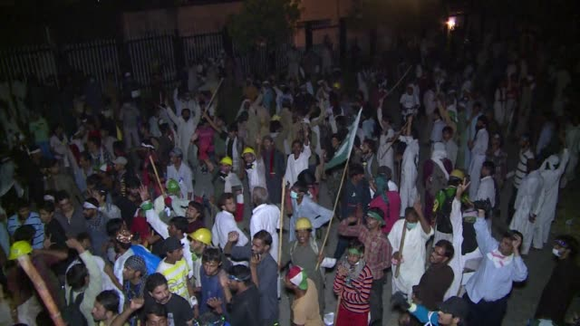 hundreds are wounded in clashes between police and protesters in pakistans capital islamabad as a fortnight long political impasse turns violent - abundance stock videos & royalty-free footage