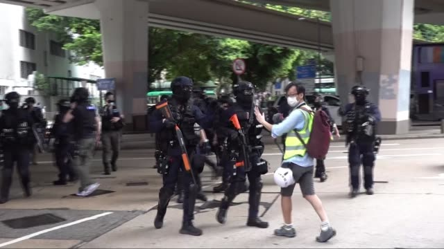 hundreds arrested in hong kong protests as security law comes into effect; hong kong: ext various shots of riot police along police officers pushing... - hong kong stock videos & royalty-free footage