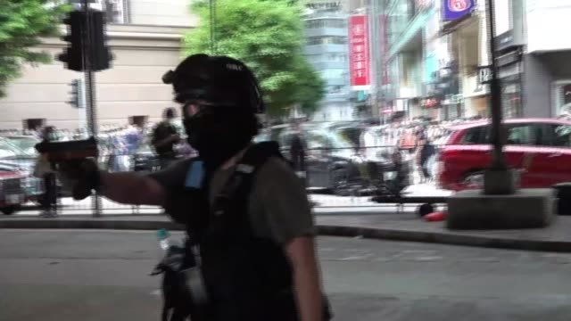 hundreds arrested in hong kong protests as security law comes into effect; hong kong: ext protester running along street and tackled to ground by... - hong kong stock videos & royalty-free footage