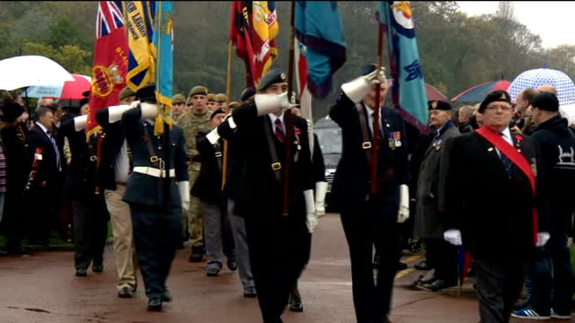 hundreds attend funeral of world war two veteran harold jellicoe percival; england: lancashire: lytham st annes: ext veterans along carrying flags at... - リザムセントアンズ点の映像素材/bロール