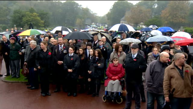 hundreds attend funeral of world war two veteran harold jellicoe percival; lancashire: lytham st annes: ext people attending funeral service - リザムセントアンズ点の映像素材/bロール