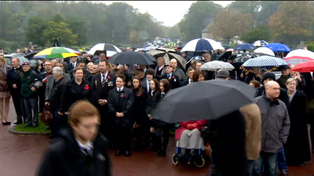 hundreds attend funeral of world war two veteran harold jellicoe percival; england: lancashire: lytham st annes: ext people gathered in the rain as... - リザムセントアンズ点の映像素材/bロール