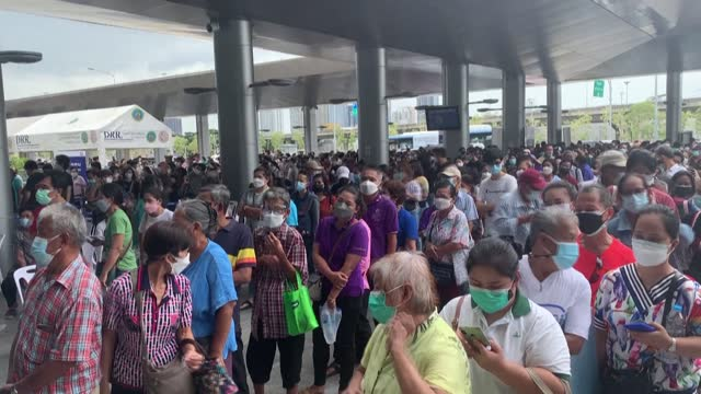 hundreds crowd at the new giant bang sue station in bangkok to get vaccinated against covid-19, making social distancing nearly impossible as the... - bangkok stock videos & royalty-free footage
