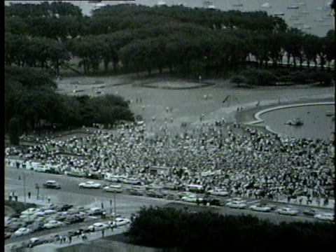 stockvideo's en b-roll-footage met hundreds gather in chicago's grant park to hear martin luther king jr. speak on july 26, 1965. - 1965