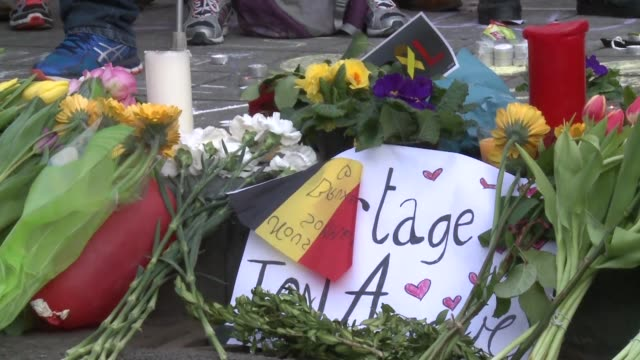 hundreds gather in the centre of brussels to pay respects to more than 30 people killed in attacks at the citys main airport and a metro station this... - belgium stock videos & royalty-free footage