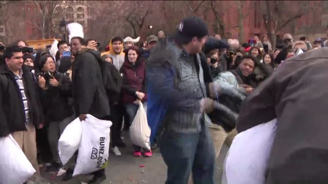 wpix hundreds gathered in washington square park in new york city on april 1 2017 to take part in the 12th international pillow fight day - pillow fight stock videos & royalty-free footage