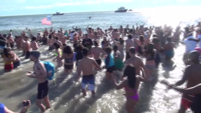 Hundreds head into the 45 degree Atlantic Ocean on New Year's Day raising funds for local charities